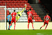 Chris Neal (1) of Fleetwood Town tips the ball away from danger during the The FA Cup match between Bristol City and Fleetwood Town at Ashton Gate, Bristol, England on 7 January 2017. Photo by Graham Hunt.