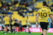 Beauden Barrett watches play during the super rugby union  game between Hurricanes  and Highlanders, played at Westpac Stadium, Wellington, New Zealand on 24 March 2018.  Hurricanes won 29-12.
