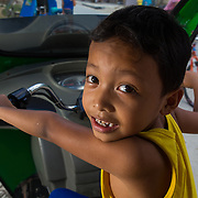 CAPTION: Brence's cousin, Carl, also lives in alongside the Marikina River, and has experienced major flooding in recent years. When floods hit this area, entire families are evacuated to higher ground and children are unable to go school for several days. LOCATION: Ampalaya Street, Barangay Tumana, Marikina City, Philippines. INDIVIDUAL(S) PHOTOGRAPHED: Carl Ochoa.