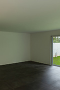 Interior of a modern apartment , empty room with  black floor