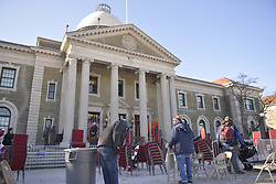 January 1, 2018 - Mineola, New York, United States - Workers remove chairs, flags, bunting from location the swearing-in ceremony of Laura Curran as Nassau County Executive was just held, in front of Theodore Roosevelt Executive & Legislative Building. Temperature was a freezing 14 ? Fahrenheit / -10 ?  Celsius for the outdoor event. (Credit Image: © Ann Parry via ZUMA Wire)