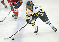 PITTSBURGH, PA - OCTOBER 14:  Bridget Baker #16 of the Vermont Catamounts skates with the puck in the second period during the game against the Robert Morris Colonials at 84 Lumber Arena on October 14, 2016 in Pittsburgh, Pennsylvania. (Photo by Justin Berl)