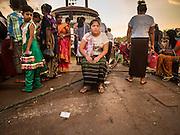 21 OCTOBER 2015 - YANGON, MYANMAR:   Passengers wait to board a cross river ferry at Botataung Pier, near Botataung Paya on the riverfront in Yangon. PHOTO BY JACK KURTZ
