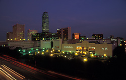 Stock photo of the Houston Galleria at night with the Williams Tower in the distance.