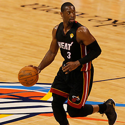 Jun 14, 2012; Oklahoma City, OK, USA;  Miami Heat shooting guard Dwyane Wade (3) dribbles against the Oklahoma City Thunder during the first quarter of game two in the 2012 NBA Finals at Chesapeake Energy Arena. Mandatory Credit: Derick E. Hingle-US PRESSWIRE