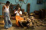 Master craftsman Pranava Stapathy instructs another craftsman whilst working on a large statue of Hanuman, the monkey God at the workshop of S. Devasenapathy Stapathy and Sons..The current Stpathy family is the twenty third generation of bronze casters dating back to the founding of the Chola Empire. The Stapathys had been sculptors of stone idols at the time of Rajaraja 1 (AD985-1014) but were called to Tanjore to learn bronze casting. Their methods using the ,?Úlost wax,?Ù process remains unchanged to this day.