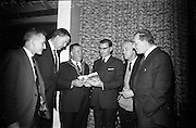 """17/05/1966<br /> 05/17/1966<br /> 17 May 1966<br /> Book reception for """"Decades of Glory: A Comprehensive History of the National Game"""" by Raymond Smith.<br /> This reception was held in the offices of W.D. & H.O. Wills to honour the well known author and journalist, Raymond Smith. His book on the history of Hurling (""""Decades of Glory"""") has just been published with the assistance of Wills of Dublin and Cork and the Central Council of the G.A.A.<br /> Picture shows (from left to right): Phil Grimes (Waterford), Mr. D.R. Mott (Managing Director of Wills of Dublin and Cork), Patrick Browne (Mayor of Waterford), Raymond Smith (Author), John Keane (Waterford), and Larry Lyons (Editor, Waterford News 2 star) chatting at the reception."""