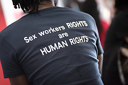 """6 December 2017, Abidjan, Côte d'Ivoire: """"Sex workers RIGHTS and HUMAN RIGHTS"""" reads a t-shirt worn by a man in the Global Village area of ICASA 2017. The 19th International Conference on AIDS and STIs in Africa (ICASA) 2017 gathers thousands of researchers, medical professionals, academics, activists and faith-based organizations from all over the world, all looking to overcome the HIV epidemic and eliminate AIDS as a public health threat."""