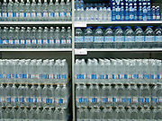 display of various bottles of bottled water in a supermarket
