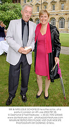 MR & MRS LESLIE SCHOFIELD he is the actor, at a party in London on 4th July 2002.	PBT 35