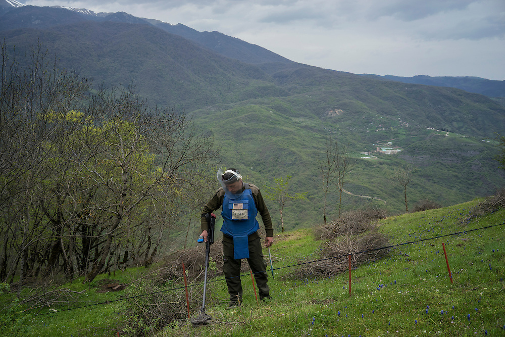 HAGOB KAMARI, NAGORNO-KARABAKH - APRIL 20: Samvel Karapetyan, a sapper with the charity HALO Trust, works to clear a minefield on April 20, 2015 in Hagob Kamari, Nagorno-Karabakh. Since signing a ceasefire in a war with Azerbaijan in 1994, Nagorno-Karabakh, officially part of Azerbaijan, has functioned as a self-declared independent republic and de facto part of Armenia, with hostilities along the line of contact between Nagorno-Karabakh and Azerbaijan occasionally flaring up and causing casualties. (Photo by Brendan Hoffman/Getty Images) *** Local Caption *** Samvel Karapetyan