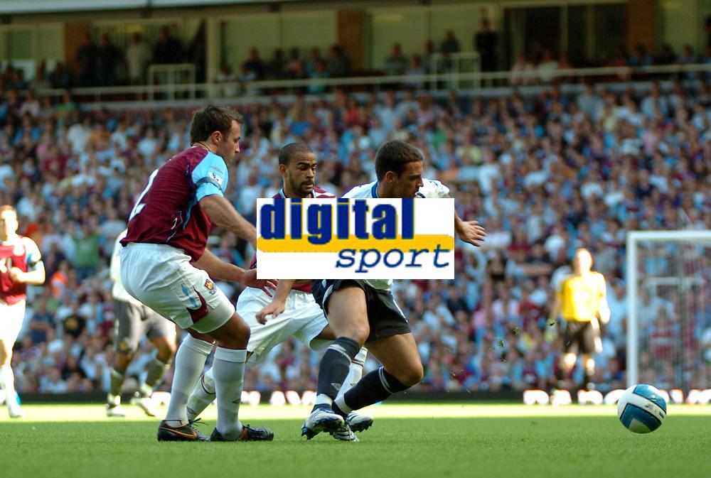 Photo: Tony Oudot.<br /> West Ham United v Wigan Athletic. The FA Barclays Premiership. 25/08/2007.<br /> Jason Koumas of Wigan goes past Lucas Neill of West Ham