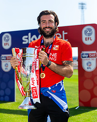 (Free to use courtesy of Sky Bet) Michael<br /> Doughty looks on as Swindon Town gather at The County Ground to celebrate becoming Sky Bet League Two Champions, with a socially distanced trophy lift, after the curtailment of the regular season due to the Covid-19 pandemic - Rogan/JMP - 26/06/2020 - The County Ground - Swindon, England - Sky Bet League 2.