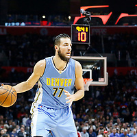 24 February 2016: Denver Nuggets center Joffrey Lauvergne (77) looks to pass the ball during the Denver Nuggets 87-81 victory over the Los Angeles Clippers, at the Staples Center, Los Angeles, California, USA.