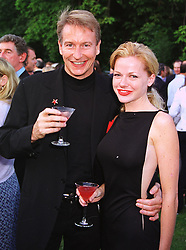 Multi millionaire German property developer MR THOMAS KRAMER and MISS MICHELLE MANNING, at a party in London on 7th July 1999.MUC 94