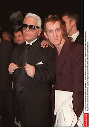© Nicolas Khayat/ABACA. 23149-15. Paris-France, 23/021/2001. Fashion stylists Karl Lagerfeld & Jeremy Scott at the Haute Couture Spring-Summer 2001 Chanel fashion show.