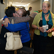 Svitlana Slesarenok (Ukraine) and Dr. Hala Yousry (Egypt), delegates to the International Women's Earth and Climate Summit, reunite before the opening of the summit. Claire Greensfelder, a delegate and summit organizer looks on.  Leaders from 35+ countries gathered for the drafting of a Women's Climate Action Agenda in Suffern, New York September 20-23rd, 2013 as part of the International Women's Earth and Climate Summit.  For a full list of Summit delegates and an agenda visit www.iweci.org. Photo by Lori Waselchuk/Magazines OUT