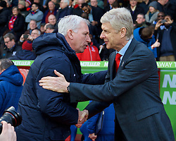 LONDON, ENGLAND - Saturday, February 21, 2015: Arsenal's manager Arsene Wenger and Crystal Palace's manager Alan Pardew before the Premier League match at Selhurst Park. (Pic by David Rawcliffe/Propaganda)