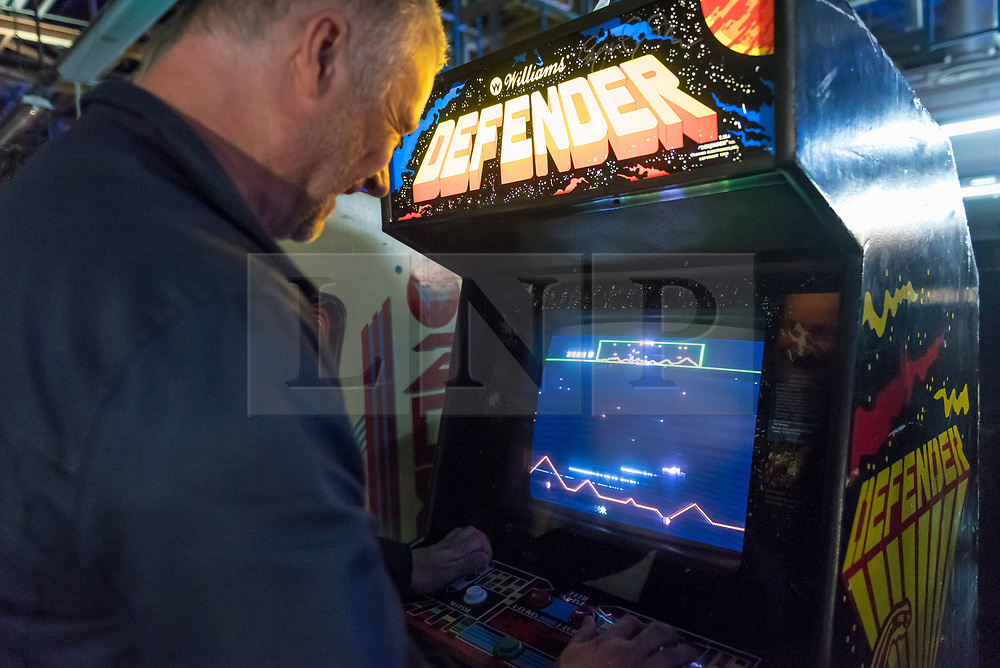 © Licensed to London News Pictures. 12/08/2018. LONDON, UK. A man plays Defender, an eighties video game, at Play Expo London, a video games show featuring consoles, handhelds, computers, vintage arcades and pinball machines, organised by Replay Events taking place at the Printworks in Canada Water, East London.  Photo credit: Stephen Chung/LNP