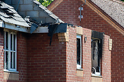 © Licensed to London News Pictures. 06/05/2020. Woolton Hill, UK. Bricks around a window are blacked by damage from a fire, above is the exposed roof area of a house destroyed by fire. A fire has destroyed two houses on Woolton Lodge Gardens, Woolton Hill in Hampshire. The fire started approximately 20:10 BST on Tuesday 05/05/2020. Photo credit: Peter Manning/LNP