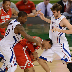 Mar 31, 2012; New Orleans, LA, USA; Ohio State Buckeyes forward Jared Sullinger (0) is defended by Kansas Jayhawks forward Thomas Robinson (0) and center Jeff Withey (5) during the second half in the semifinals of the 2012 NCAA men's basketball Final Four at the Mercedes-Benz Superdome. Mandatory Credit: Derick E. Hingle-US PRESSWIRE