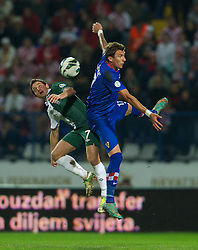 OSIJEK, CROATIA - Tuesday, October 16, 2012: Wales' Joe Allen in action against Croatia's Mario Mandzukic during the Brazil 2014 FIFA World Cup Qualifying Group A match at the Stadion Gradski Vrt. (Pic by David Rawcliffe/Propaganda)