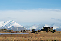 Old farmhouse in Mýrar, Southeast Iceland. Mount Hoffellsfjall in background left.