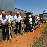 Rady Taylor, left, grabs his shovel and joins the group to breakground for the new Jim Ingram Red Shield Lodge at the Salvation Army on Carnation Street in Tupelo on Tuesday.