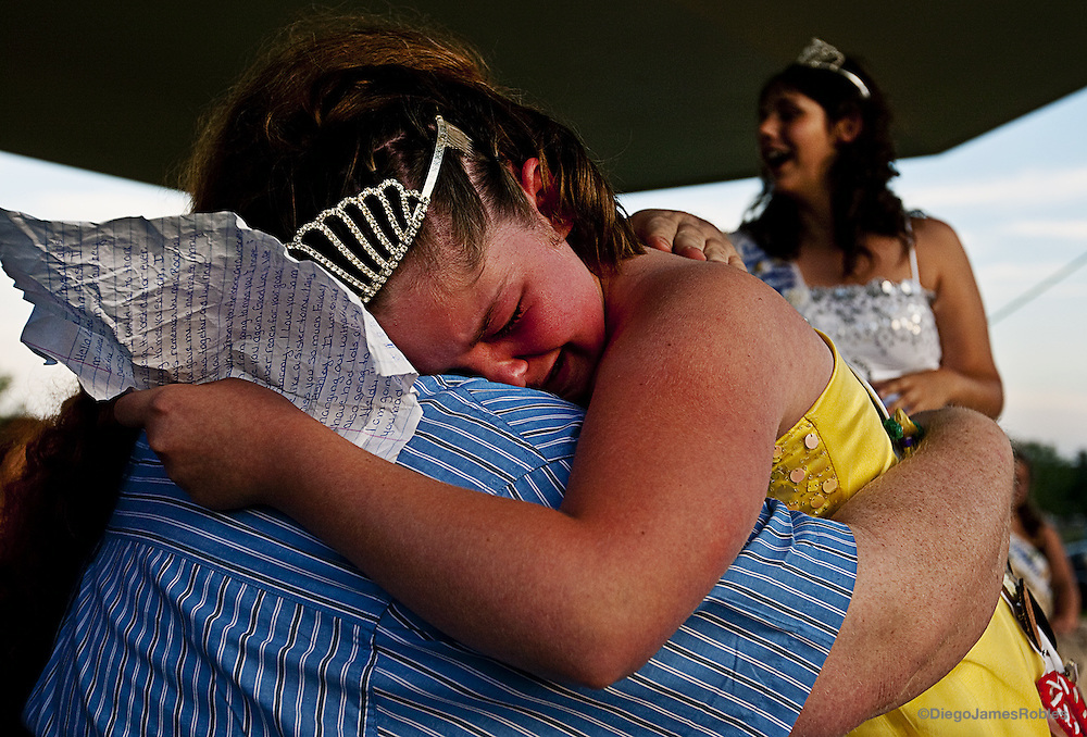 "While reading her farewell speech to a large crowd of parents, supporters and local residents, Racheal LeAnn Frost breaks down in tears and falls into the arms of her longtime friend and pageant chairman, Kevin Bennett, on Saturday afternoon, June 6, 2009, in Chauncey, Ohio. The 2008-2009 Jr. Miss of the Chauncey Dover Spring Festival, said, ""I will miss all the girls but especial you Kevin."""