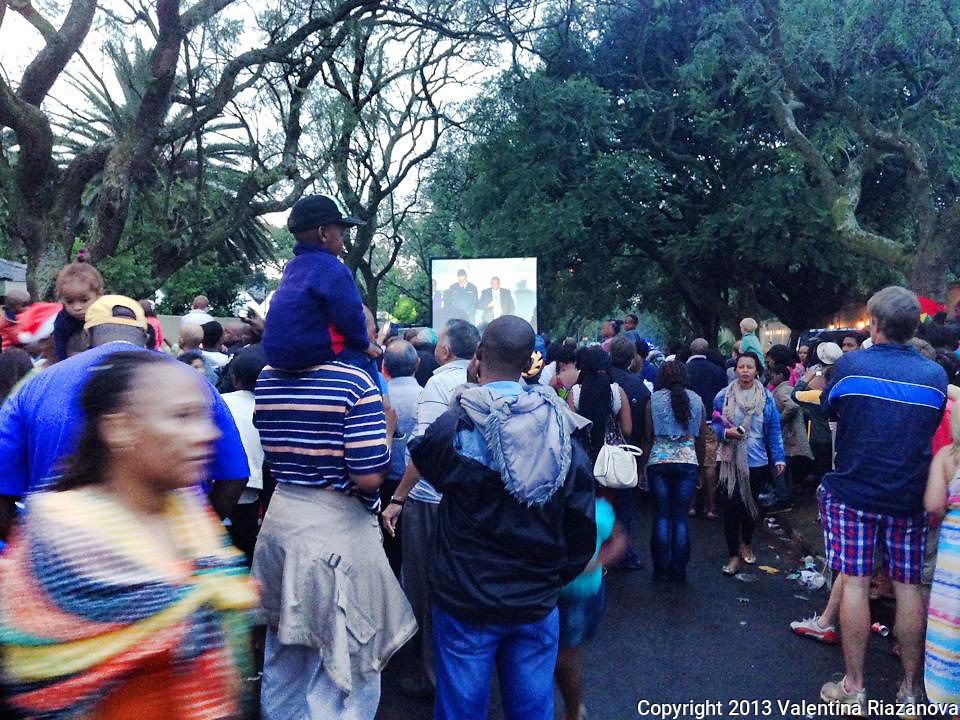 People still came in their thousands to Nelson Mandel'as home three days after he died. The mood was sad yet festive. Johannesburg, South Africa.
