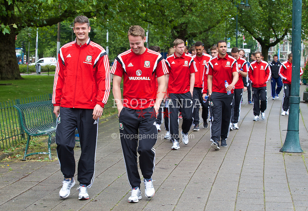 AMSTERDAM, NETHERLANDS - Tuesday, June 3, 2014: Wales' Owain Tudur Jones and Chris Gunter during a walk near their hotel ahead of the International Friendly match against the Netherlands. (Pic by David Rawcliffe/Propaganda)