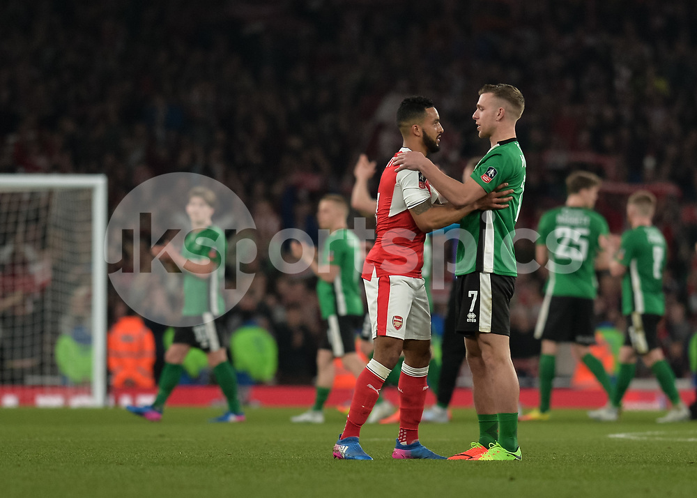 Theo Walcott of Arsenal and Jack Muldoon of Lincoln City embrace after the The FA Cup sixth round match between Arsenal and Lincoln City at the Emirates Stadium, London, England on 11 March 2017. Photo by Vince Mignott.