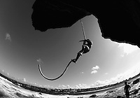 SYDNEY, AUSTRALIA - AUGUST 20:  (EDITOR'S NOTE: This digital image has been converted to black and white) A climber ascends the rope at Bondi Beach on August 20, 2011 in Sydney, Australia. A group of local Sydney men, including a number of World Record holders, meet three times a week to scale a five-metre rope bare handed.  (Photo by Marianna Massey/Getty Images)