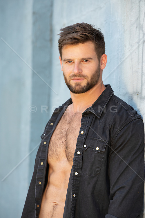 good looking man with an open shirt