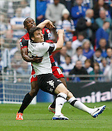 Chris Martin of Derby County battles with Nedum of Queens Park Rangers during the Sky Bet Championship Play Off final at Wembley Stadium, London<br /> Picture by Andrew Tobin/Focus Images Ltd +44 7710 761829<br /> 24/05/2014