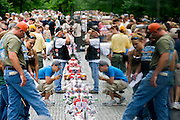 Visitors to the Vietnam Veterans Memorial are reflected in the surface as they pay their respects on Sunday May 24, 2009.