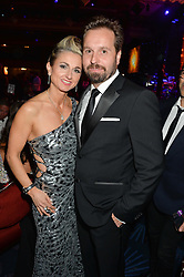 TRUDI BESWICK and ALFIE BOE at the Caudwell Children's annual Butterfly Ball held at The Grosvenor House Hotel, Park Lane, London on 15th May 2014.