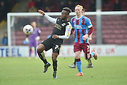 Drissa Traore (7) of Swindon Town takes ball during the Sky Bet League 1 match between Scunthorpe United and Swindon Town at Glanford Park, Scunthorpe, England on 28 March 2016. Photo by Ian Lyall.