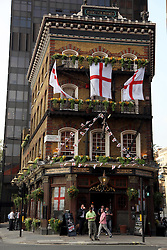 21 April 2011. London, England..The Albert Tavern near Victoria Station in the run up to Catherine Middleton's marriage to Prince William. The pub is decked out with English flags..Photo; Charlie Varley.