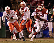 University of Oklahoma quarterback Paul Thompson (12) scrambles up filed against Nebraska during the Big 12 Championship game at Arrowhead Stadium in Kansas City, Missouri, December 2, 2006.  Oklahoma beat Nebraska 21-7.<br />