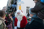 FATHER CHRISTMAS, Belgravia Christmas Sunday. Elizabeth Street, Motcomb Street and Pimlico Rd. various Christmas activities. Father Christmas will also visited each street on his sleigh pulled by his reindeer. London. 6 December 2009<br />  <br />  *** Local Caption *** -DO NOT ARCHIVE-&copy; Copyright Photograph by Dafydd Jones. 248 Clapham Rd. London SW9 0PZ. Tel 0207 820 0771. www.dafjones.com.<br /> FATHER CHRISTMAS, Belgravia Christmas Sunday. Elizabeth Street, Motcomb Street and Pimlico Rd. various Christmas activities. Father Christmas will also visited each street on his sleigh pulled by his reindeer. London. 6 December 2009