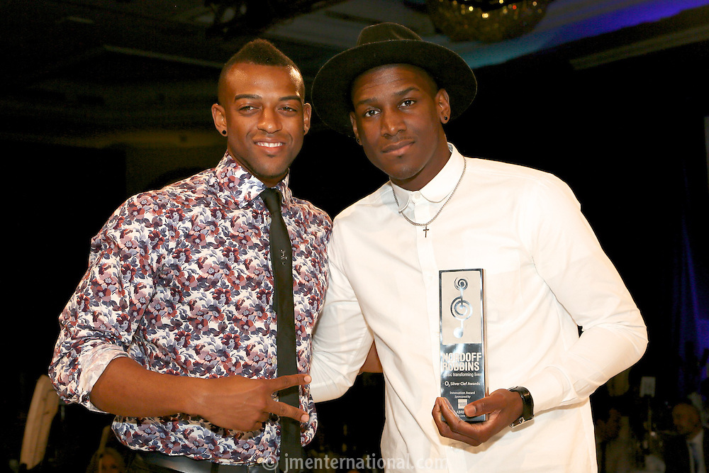 (L-R) Oritsé Williams and Labyrinth. The Silver Clef Lunch 2013 in aid of  Nordoff Robbins held at the London Hilton, Park Lane, London.<br /> Friday, June 28, 2013 (Photo/John Marshall JME)