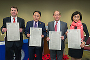 L-R: Houston ISD chief academic officer Andrew Houlihan, Director General Louis M. Huang of the Taipei Economic and Cultural Office in Houston, trustee Greg Meyers and Sophie Chou display partnership agreements signed during a ceremony, December 17, 2015.
