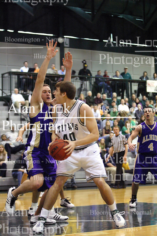30 December 2006: Brett Chamernik looks past a defender at the hoop. The Titans outscored the Britons by a score of 94-80. The Britons of Albion College visited the Illinois Wesleyan Titans at the Shirk Center in Bloomington Illinois.<br />