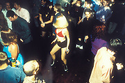 Blond woman in skimpy outfit, rave at Island night club, U.K, 1996.