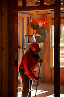 NC State volunteers work on the Build-A-Block Habitat for Humanity project.