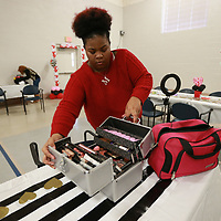 "Tyaisha Gunn begins unpacking her cosmetics and seting up in the gym at the State Hospital on Briar Ridge Road in Tupelo as part of a ""love Yourself Day"" the facility is doing for it's patients."