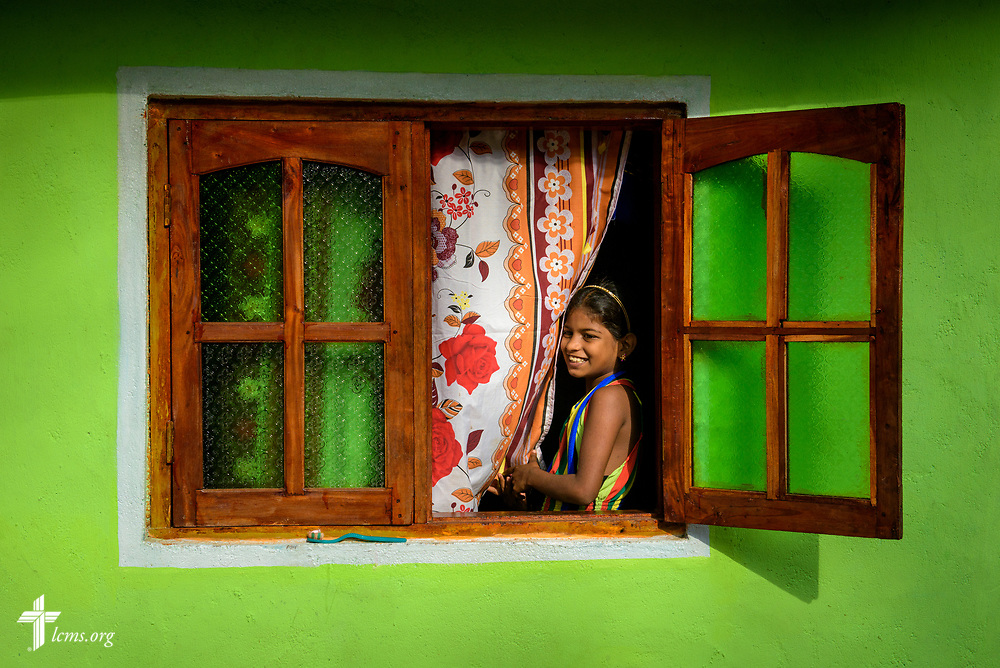 A young girl at her window on the Eila rubber plantation in the Sabaragamuwa Province of Sri Lanka on Saturday, Jan. 20, 2018. LCMS Communications/Erik M. Lunsford
