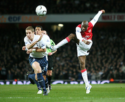 LONDON, ENGLAND - Wednesday, January, 9th, 2007: Arsenal's Abou Diaby and Tottenham Hotspur's Michael Dawson during the League Cup Semi-Final 1st Leg match against Arsenal at the Emirates Stadium. (Pic by Chris Ratcliffe/Propaganda)