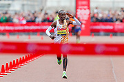 Eliud Kipchoge (Kenya) approaching the finish line and salutes the crowd in the Men's Elite race in the Virgin Money 2019 London Marathon, London, United Kingdom on 28 April 2019.